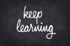 Keep learning written on chalkboard Stock Photo