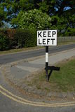 Keep left sign. A retro road sign saying 'Keep Left Stock Image