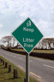 Keep litter free road sign. On a quiet road entering a town in ireland Stock Images