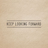 Keep looking forward on brown tissue paper Stock Photography