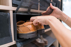 Keep the man shoes on the shoe rack. Arrange and neatly and close net protect stock image