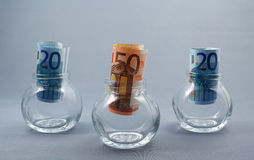 Keep the money. Twenty Euro banknotes in three glass jars royalty free stock photo