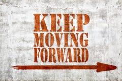Keep moving forward - graffiti on stucco wall royalty free stock images