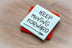 Keep moving forward reminder note royalty free stock photography