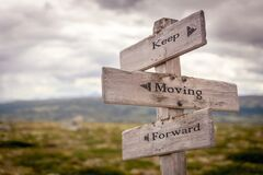 Free Keep Moving Forward Text Engraved On Old Wooden Signpost Outdoors In Nature Stock Photo - 182606880