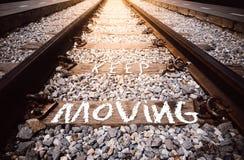 Keep moving phrase handwritten on railway.  Stock Photo
