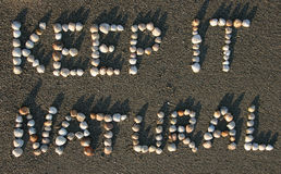 Keep it natural. Shells on the beach saying keep it natural Royalty Free Stock Images