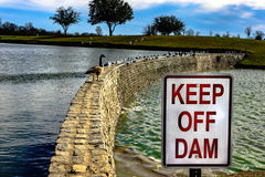 Keep off the damn dam Royalty Free Stock Photography