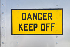 Keep Off. Danger Keep Off, yellow warning sign on the fuselage of a helicopter, USA royalty free stock photos