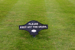 Keep off the grass sign. A black keep off the grass sign stock images
