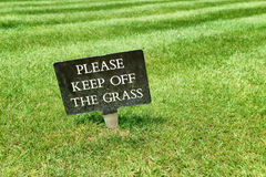 Keep Off The Grass sign on a green lawn Royalty Free Stock Photos