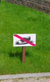 Keep off grass. Sign with a picture symbolizing ban on entry on the lawn Stock Photos