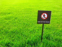 Keep off the grass, warning sign. Warning sign on lawn. Keep off the grass Stock Photography