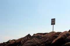 Keep off the rocks Stock Image