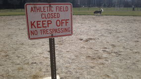 Keep off sign in athletic field Stock Photography