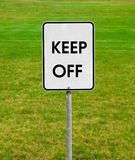 Keep off. Sign on the green lawn Stock Image