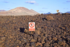 Keep-off sign in volcanic landscape of the Timanfaya National Park in Lanzarote Stock Image