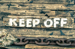 Keep Off sign - Wooden painted background Royalty Free Stock Photos