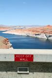 Keep off the wall sign on a dam Royalty Free Stock Photo