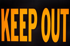 Keep Out. Close up of a black and yellow keep out sign stock image