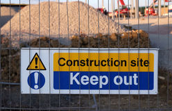 Keep Out. Sign fixed to a metal fence around building works Stock Image