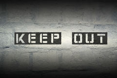 Keep out GR. Keep out stencil print on the grunge brick wall with gradient effect Stock Image