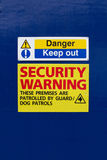 Keep out security warning sign. On blue background stock photography