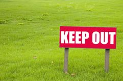 Keep Out Sign. On a green lawn Stock Photography