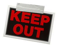 Keep Out Sign. Red and black keep out sign with tape holding it up isolated on a white background Stock Image