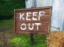 Keep Out sign. Wooden Keep Out warning sign royalty free stock photos
