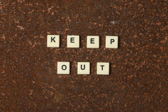 Keep out. Text on a rustic background stock photo