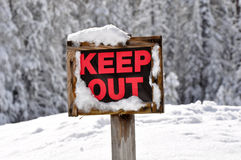 Keep Out Wooden Sign in Snow Royalty Free Stock Image