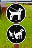 A keep pets on leash and pickup poop sign.  stock photography