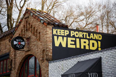 Keep Portland Weird Record Shop Sign. PORTLAND, OR - FEBRUARY 2, 2016: Keep Porltland Weird sign at a well known record store in downtown PDX Royalty Free Stock Photos