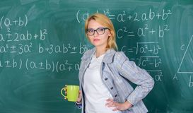 Keep positive attitude to work. Woman with tea cup chalkboard background. Prevent burnout concept. Time to relax. Teacher drink tea or coffee and stay positive royalty free stock photo
