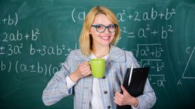 Keep positive attitude to work. Woman with tea cup and document folder chalkboard background. Time to relax. Teacher. Drink tea or coffee and stay positive stock image