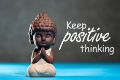 Keep positive thinking, do not negative, motivation text with little buddha figurine. Think positive, Yoga and. Meditation concept royalty free stock photography