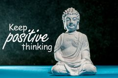 Keep Positive thinking - motivating message concept with Little Buddha statue. Think positive, be happy.  Royalty Free Stock Photography