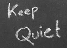 Keep Quiet written in a black board Royalty Free Stock Images