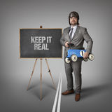 Keep it real text on blackboard with businessman Stock Images