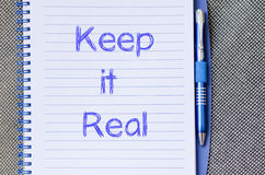 Keep it real write on notebook Stock Photography