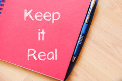 Keep it real write on notebook Royalty Free Stock Photo