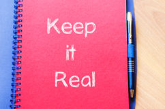 Keep it real write on notebook Stock Images