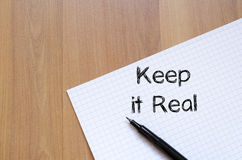 Keep it real write on notebook Royalty Free Stock Images