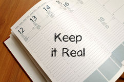 Keep it real write on notebook Royalty Free Stock Photography