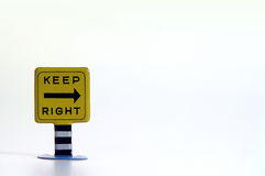 Keep Right Sign. Tin toy road sign bearing the message Keep Right with a directional arrow Royalty Free Stock Photography