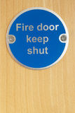 Keep shut sign on fire door Royalty Free Stock Images