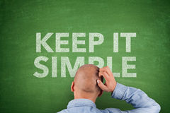 Keep It Simple on Blackboard Stock Photo