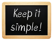 Keep it simple - chalkboard with text on white background Royalty Free Stock Images