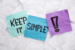 Keep it simple. Reminder or advice handwritten on colorful sticky notes Royalty Free Stock Images